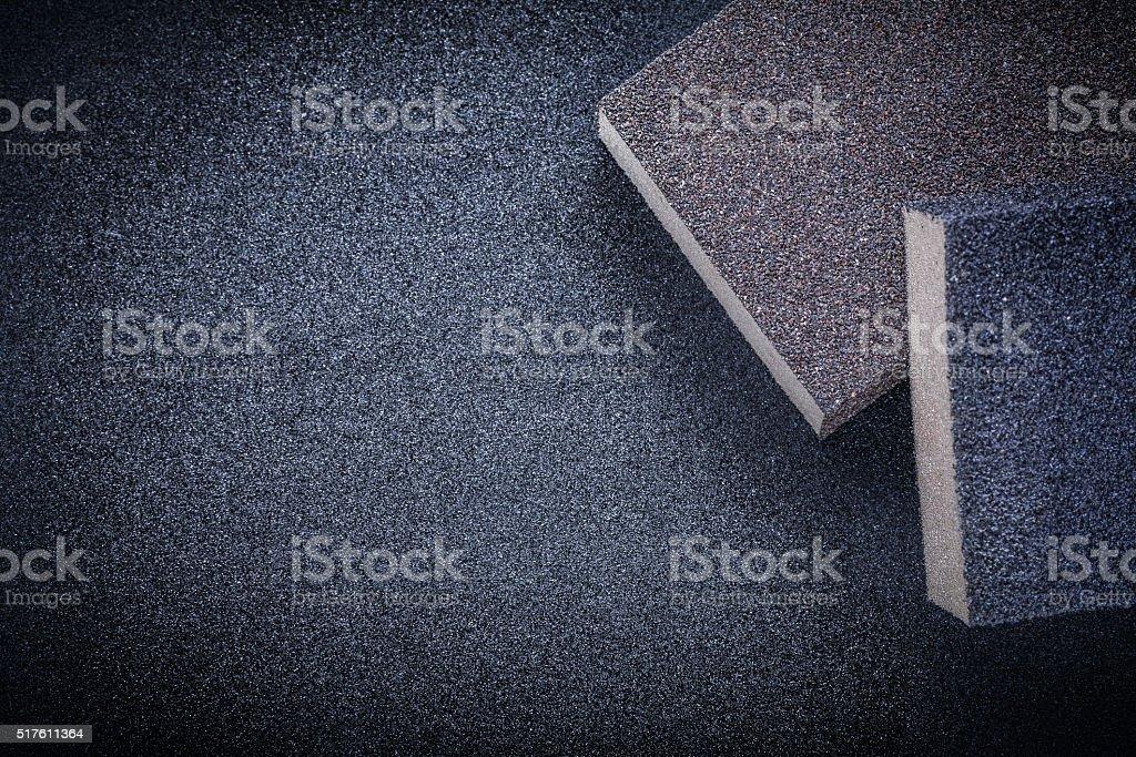Abrasive sponges on emery paper stock photo