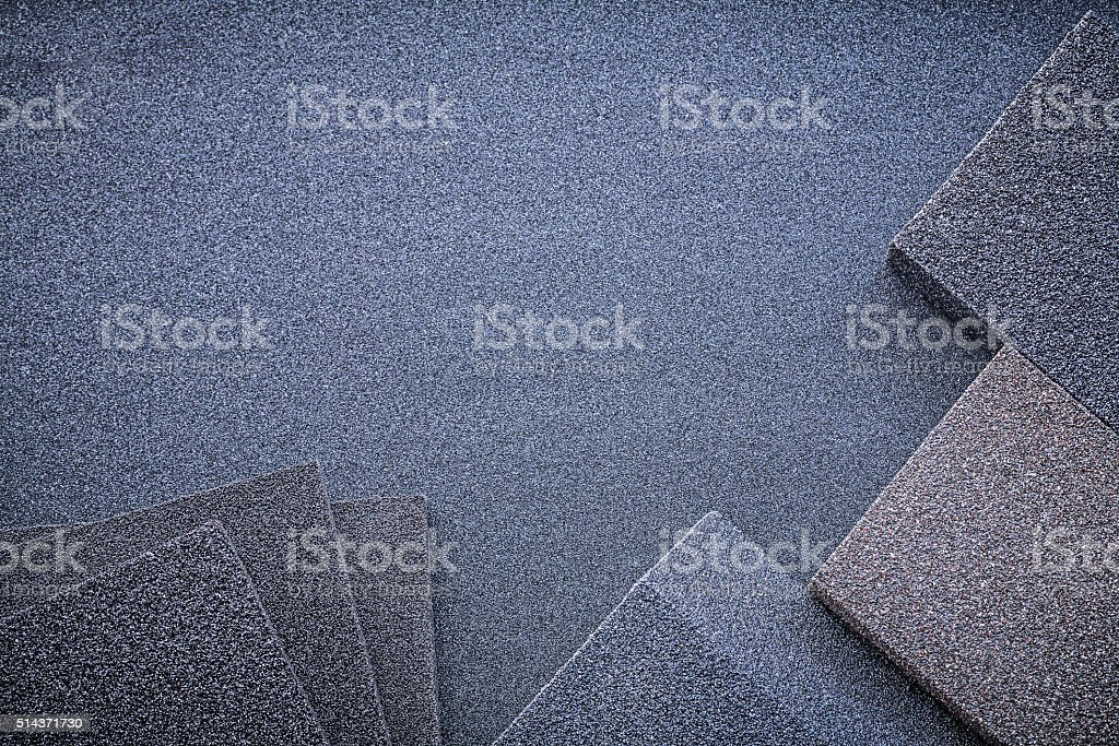 Abrasive sponges on emery paper top view stock photo