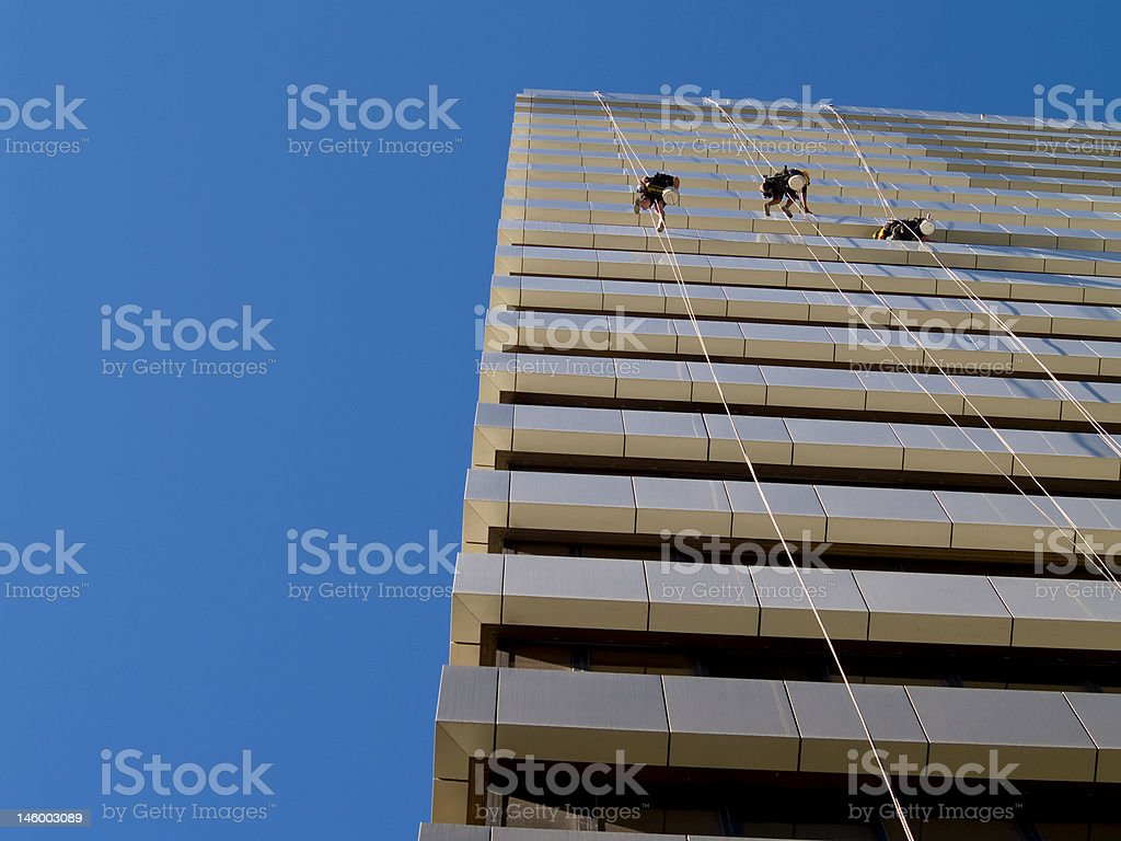 Abseiling Window cleaners stock photo