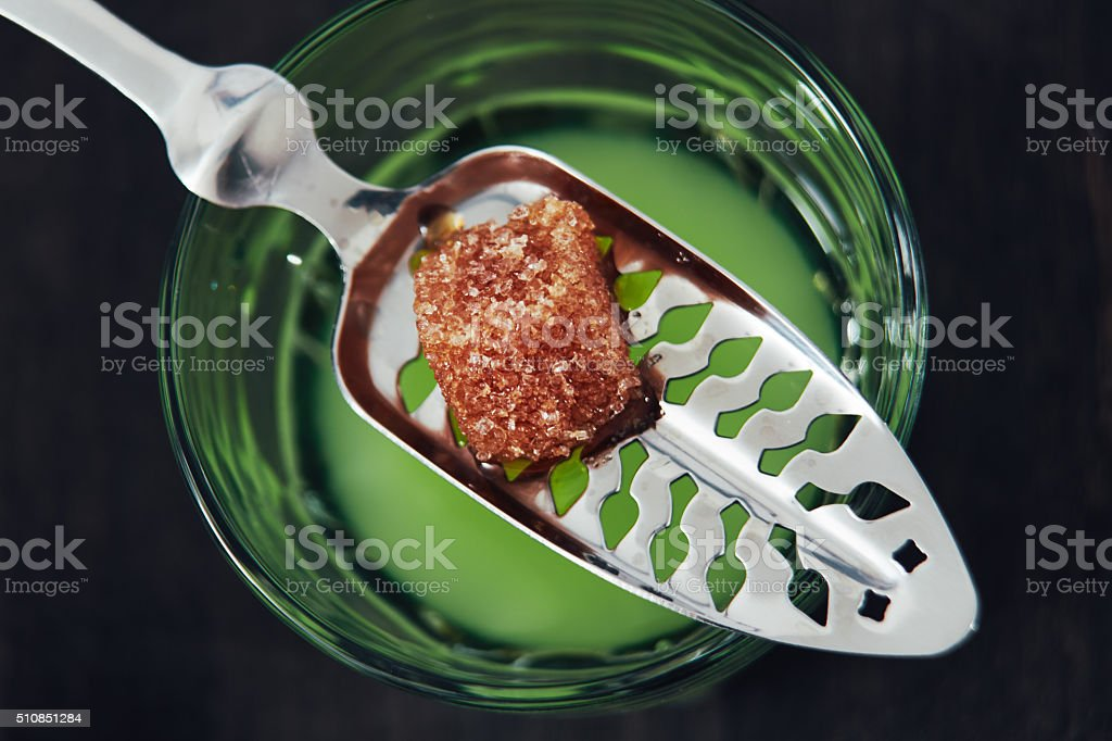 Absinthe With Spoon and Sugar Cube stock photo