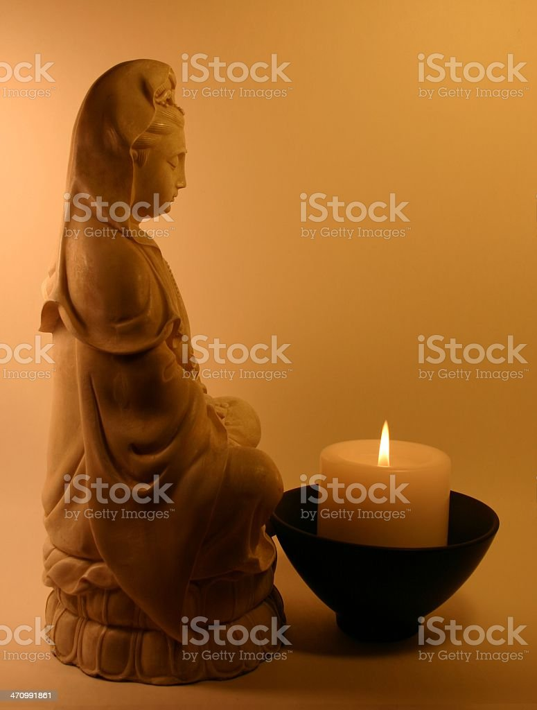 Absolute Serenity-Kwan Yin And Candle royalty-free stock photo