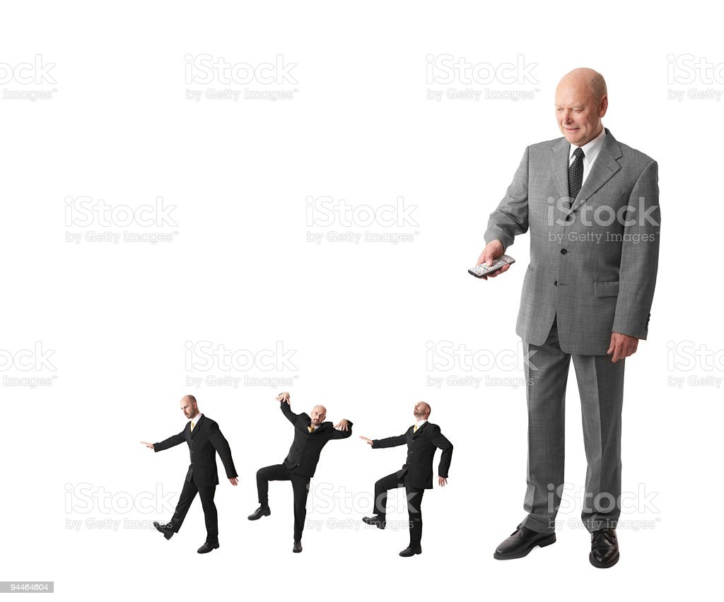 absolutism - boss controlling his workers stock photo