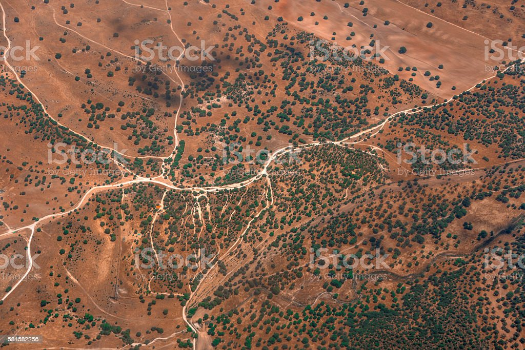 Abstract aerial landscape with dusty roads like rivers stock photo