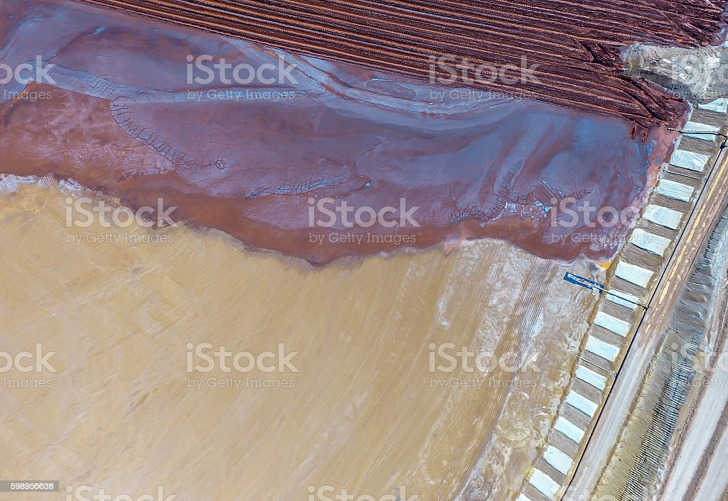 Abstract Aerial View of Red Tailing Ponds with Colorful Textures stock photo