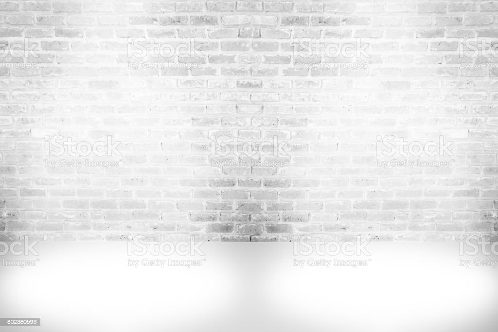 Abstract aged paint white brick wall background , grunge rusty blocks of stonework horizontal architecture wallpaper with spotlight lamps stock photo
