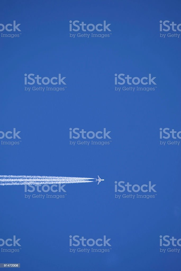 abstract aircraft flying through blue sky royalty-free stock photo