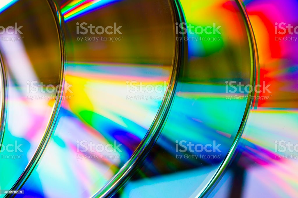 abstract background band cd discs defocused light refraction reflection stock photo