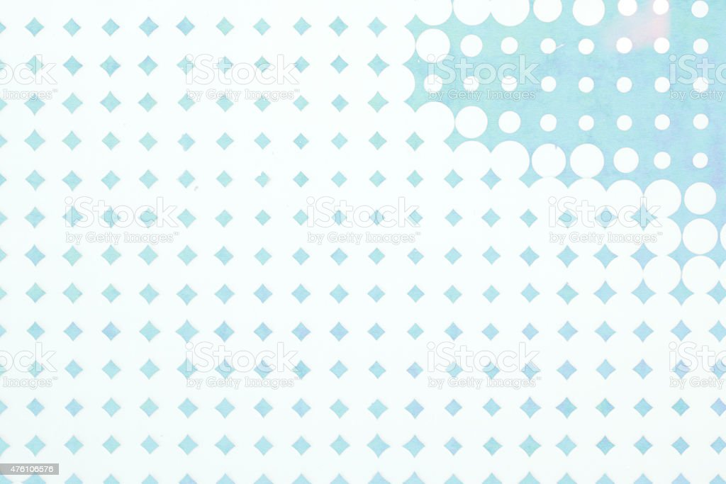 abstract background - blue pop dots on textured colored paper stock photo