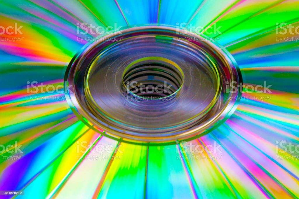 abstract background cd disk with the defocused image of green stock photo