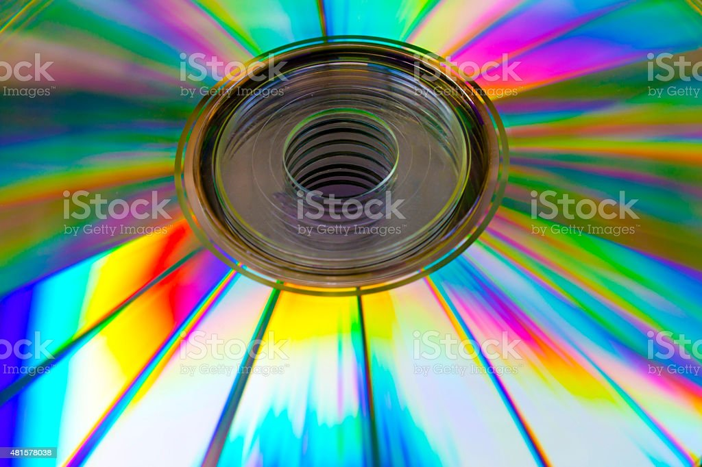 abstract background cd disk with the defocused image of purple stock photo