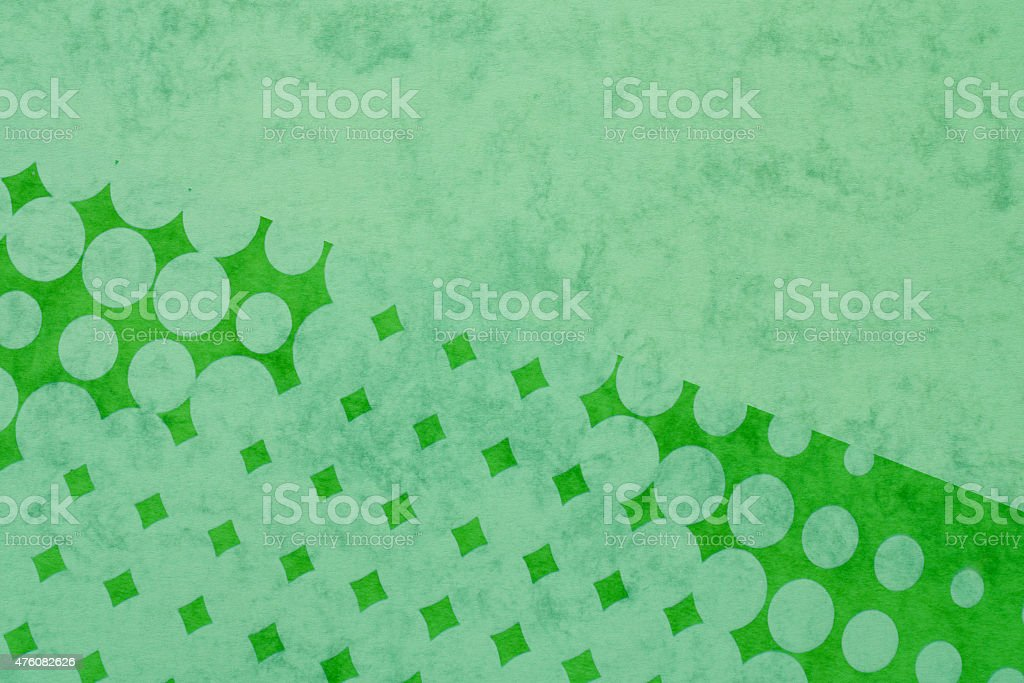 abstract background - green pop dots on textured colored paper stock photo