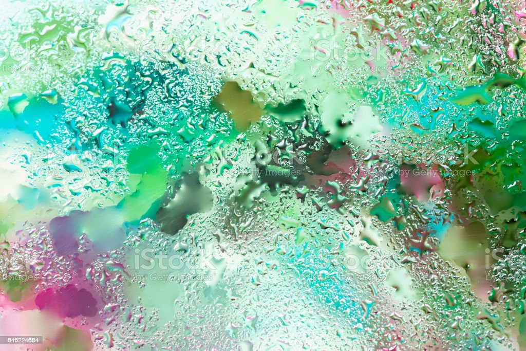 Abstract background in vibrant colors with raindrops, blurred style. Vivid tints for modern pattern, wallpaper or banner design. With place for your text stock photo