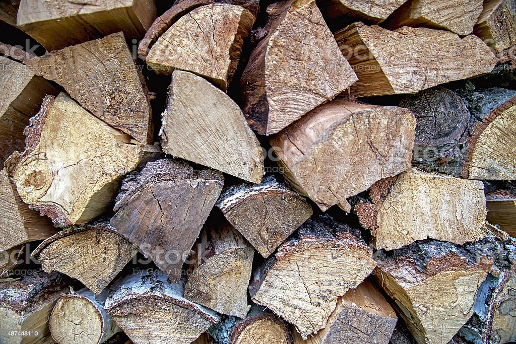 Abstract background (texture) of dry firewood in a pile. stock photo