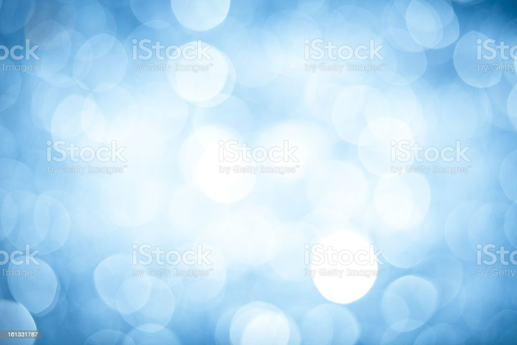 Abstract background with blurred blue sparkles royalty-free stock photo
