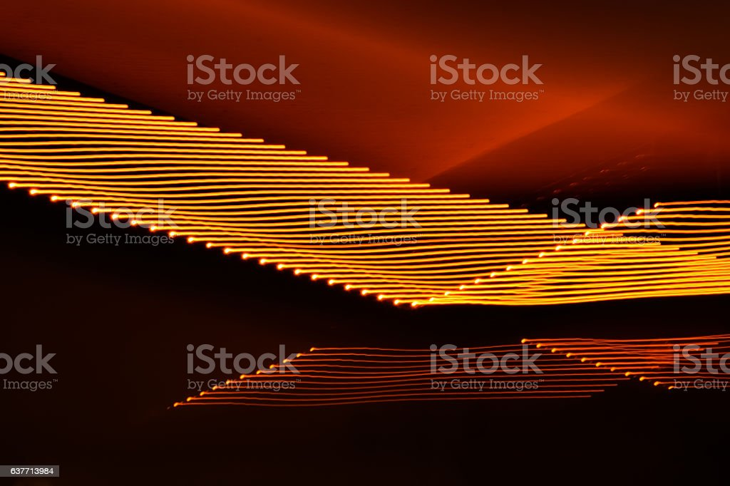 Abstract black and orange fluorescent light background stock photo