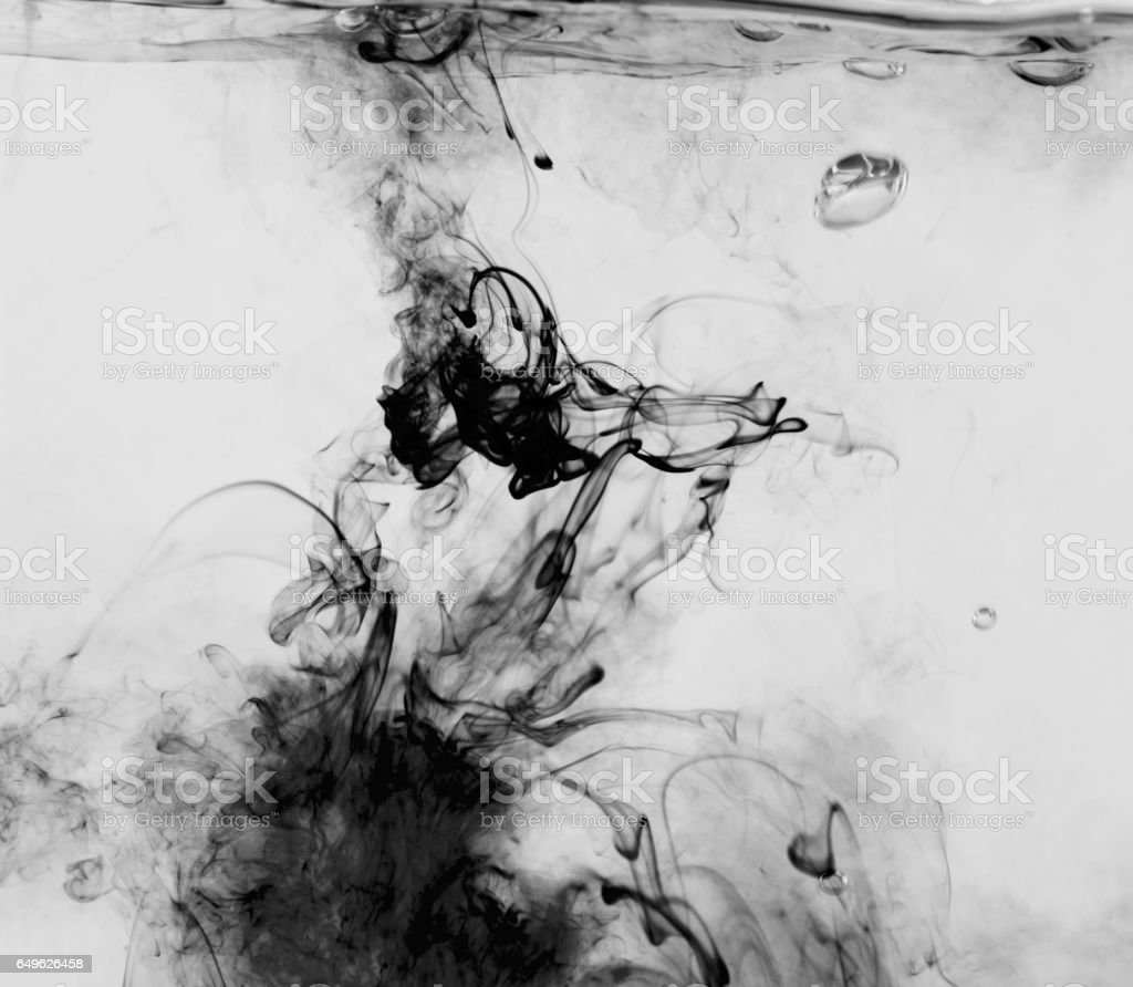 Abstract black and white image of ink flowing in water stock photo