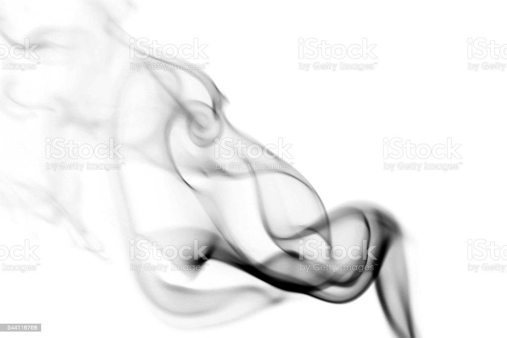 Abstract black smoke swirls over white background stock photo