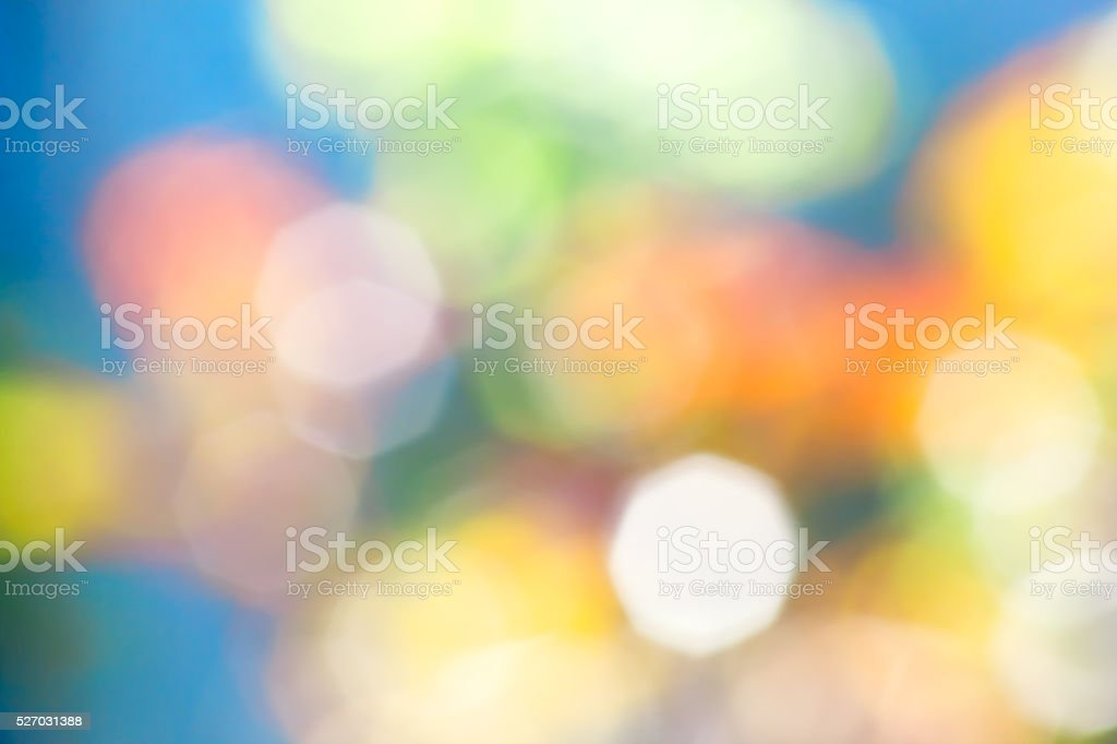 Abstract blue background with blurred colored spots stock photo