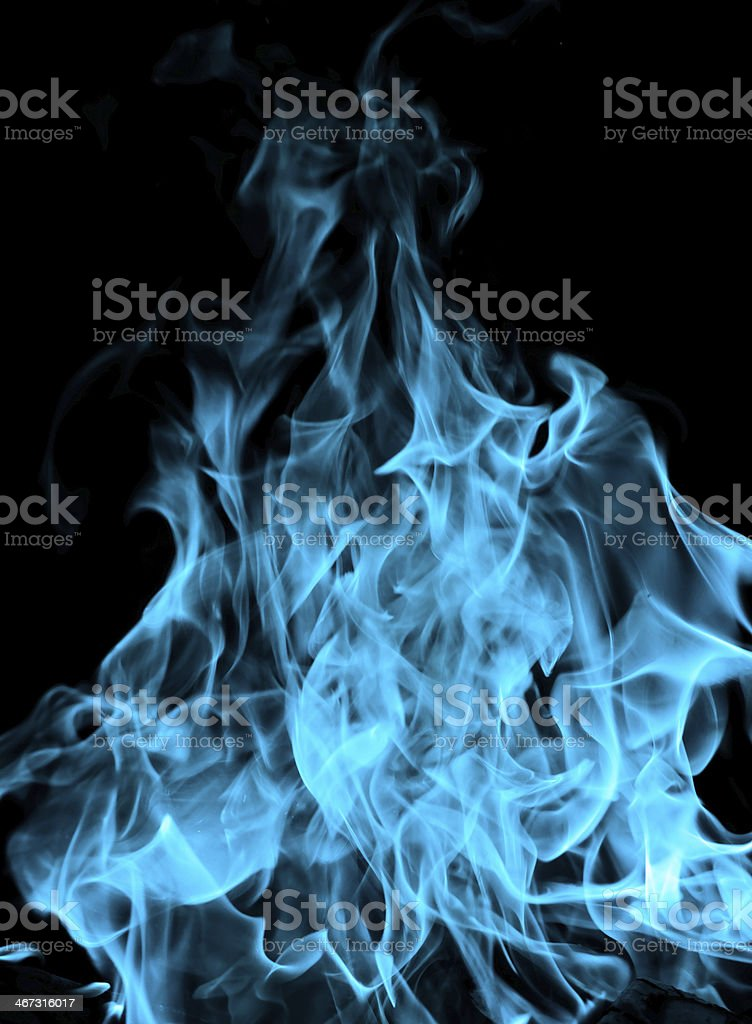 Abstract blue flames on black background stock photo