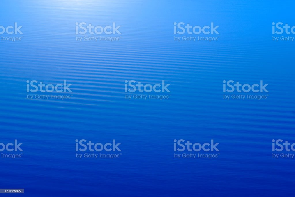 Abstract blue water background with horizontal stripes royalty-free stock photo