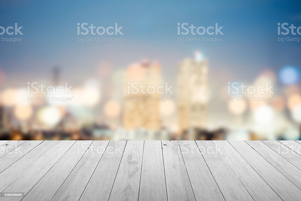 abstract blur cityscape background with wooden floor stock photo