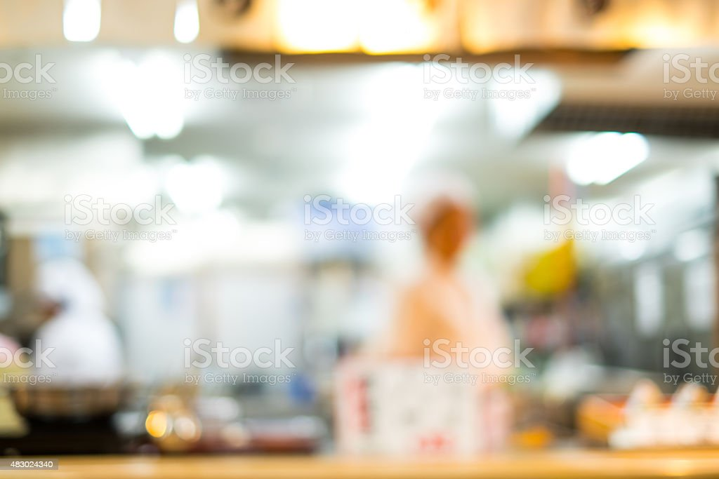 Abstract blur of Japanese restaurant with chef in the background stock photo