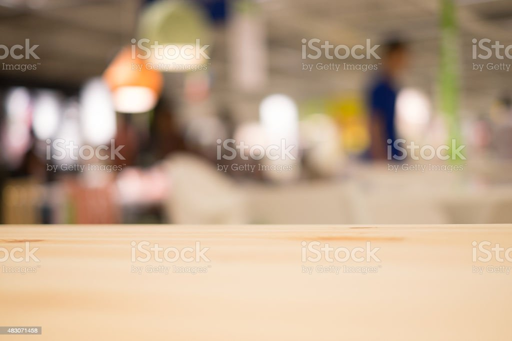 Abstract blur of restaurant with wood table stock photo