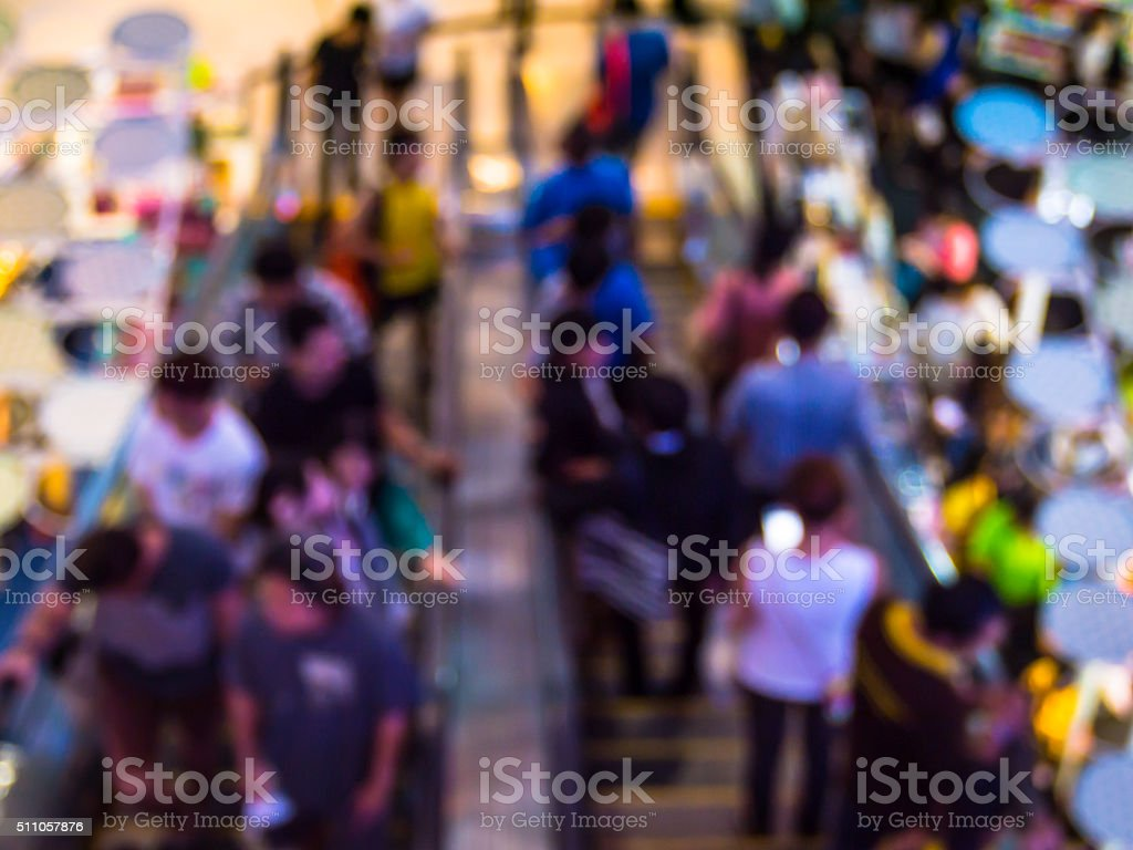 Abstract blur people in escalators at the modern shopping mall. stock photo