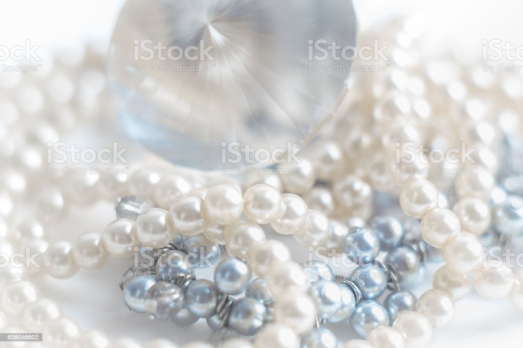 Abstract blurred background, pearl necklace on white. stock photo