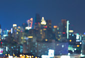 Abstract blurred bokeh lights night view, city office building downtown