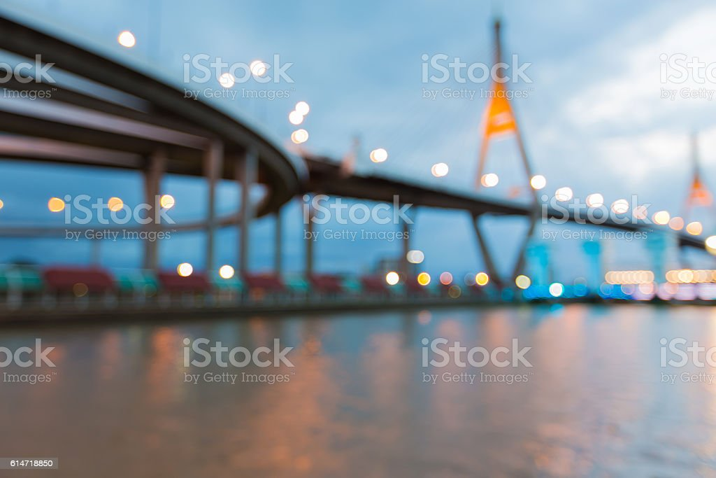Abstract blurred bokeh lights suspension bridge over watergate stock photo
