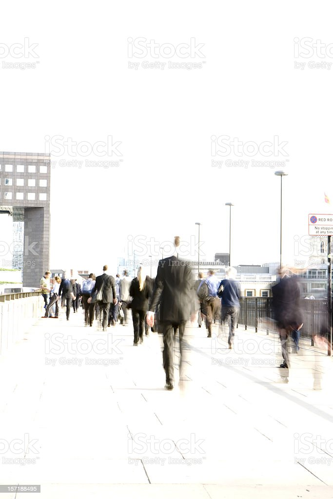Abstract, blurred City workers rushing across London Bridge stock photo