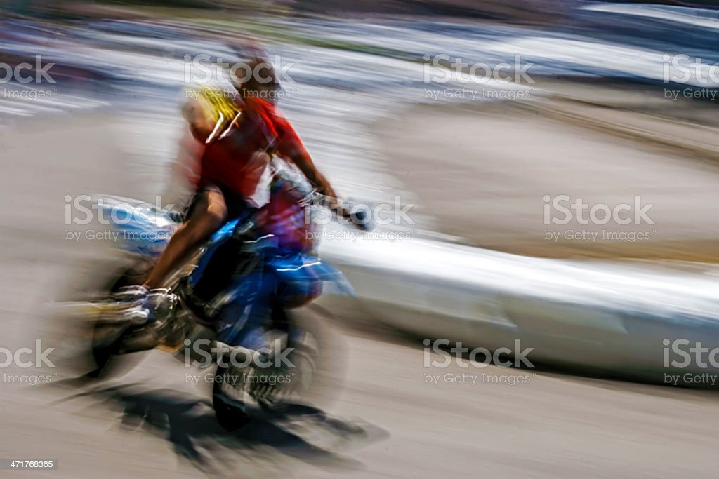 Abstract blurred motion motorcyclist royalty-free stock photo