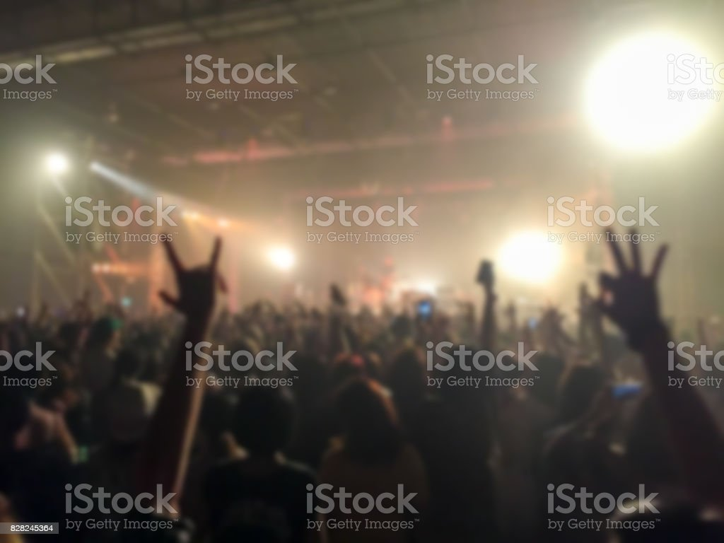 Abstract blurred of concert with hands up having fun . stock photo