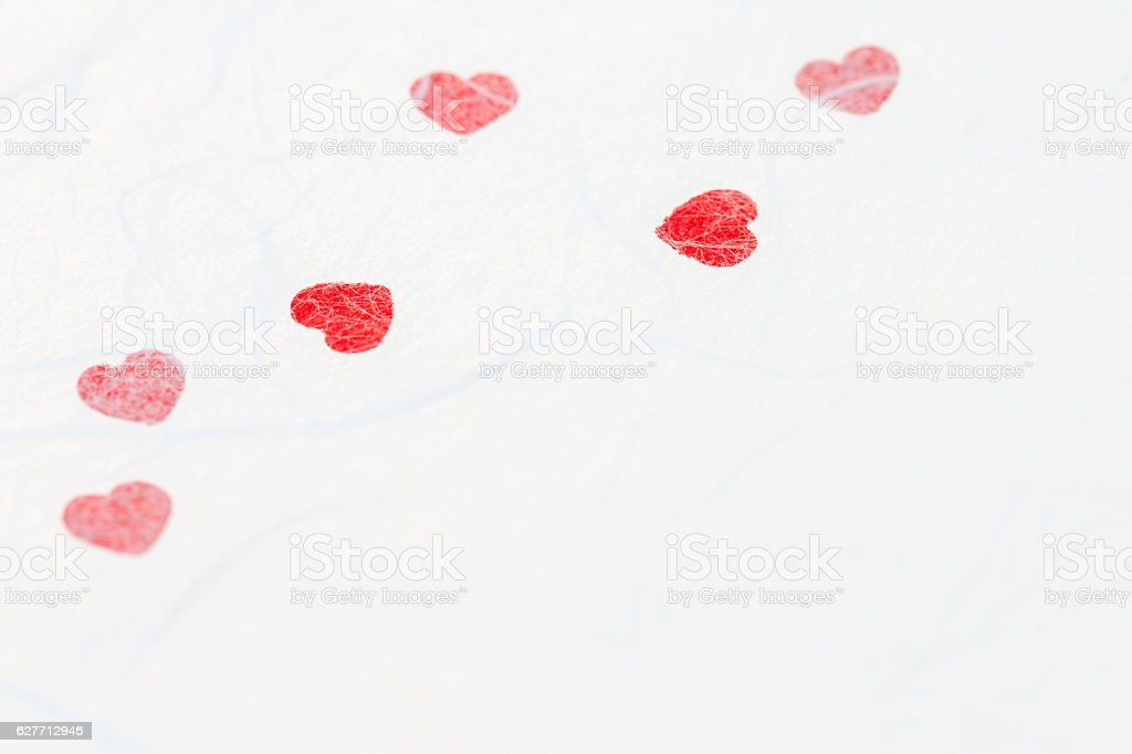 Abstract blurred of red heart on white mulberry paper texture. stock photo