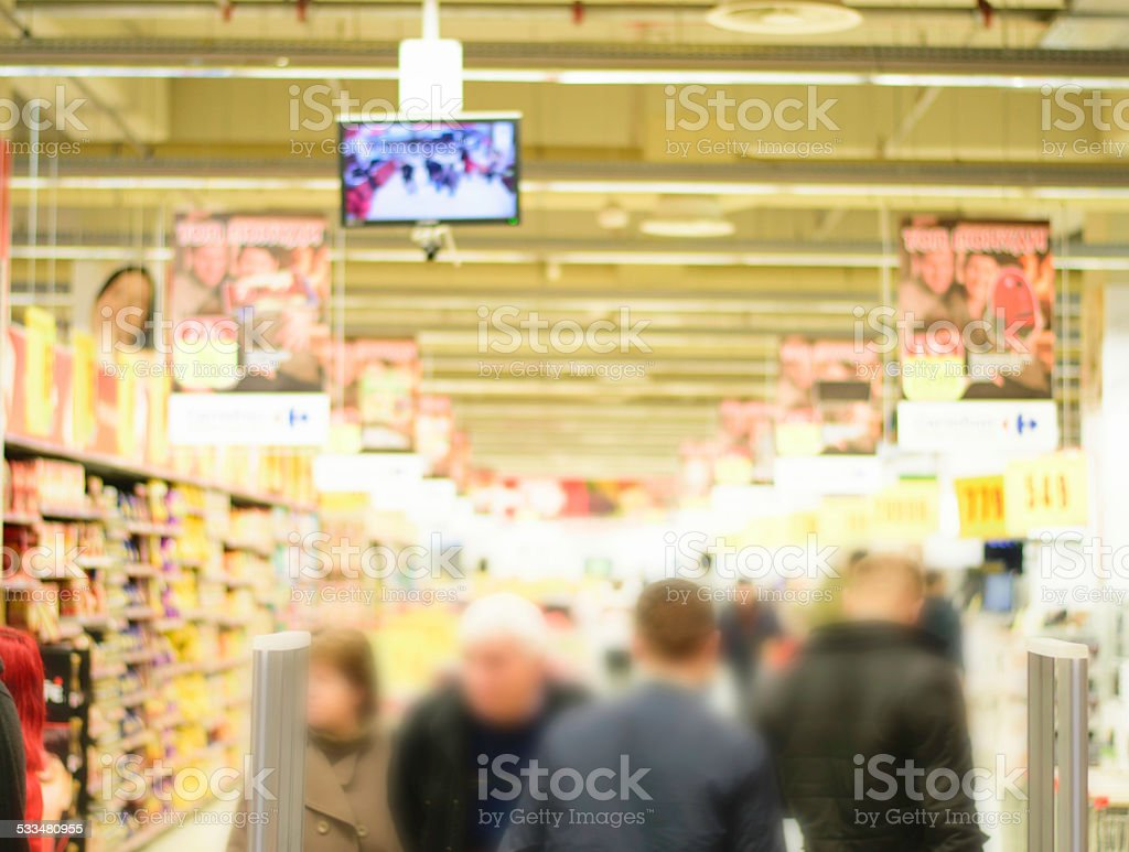 Abstract blurred people in shopping center stock photo