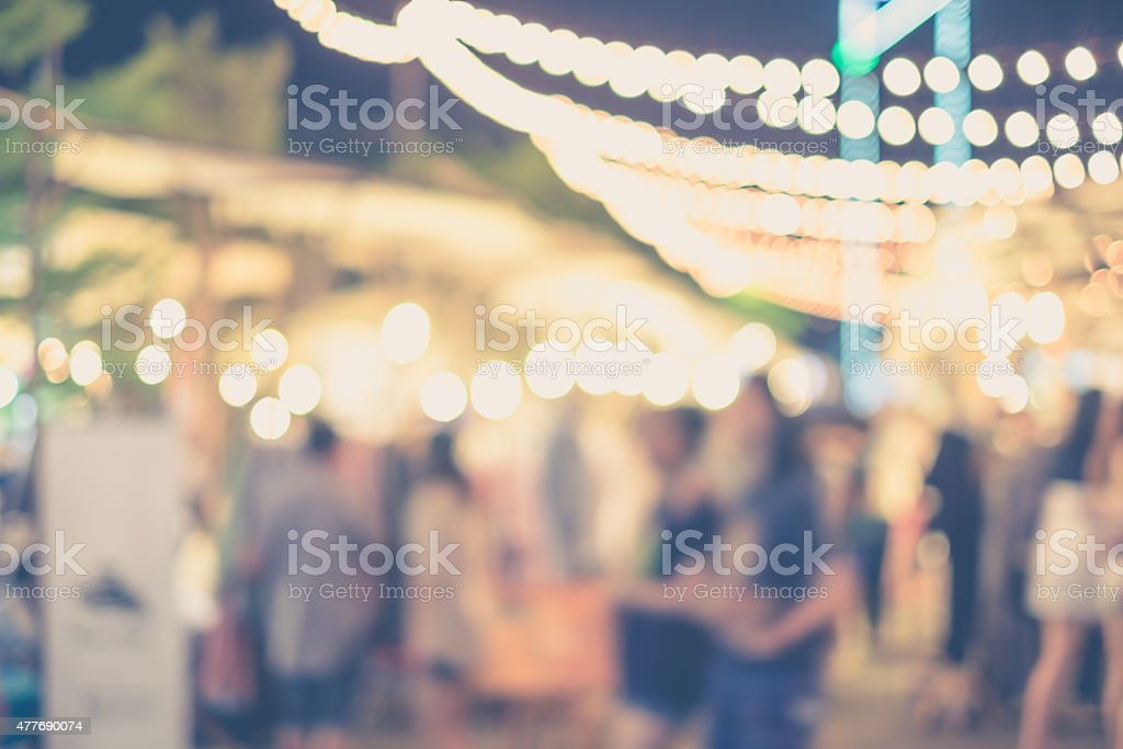 Abstract blurred people in street market stock photo