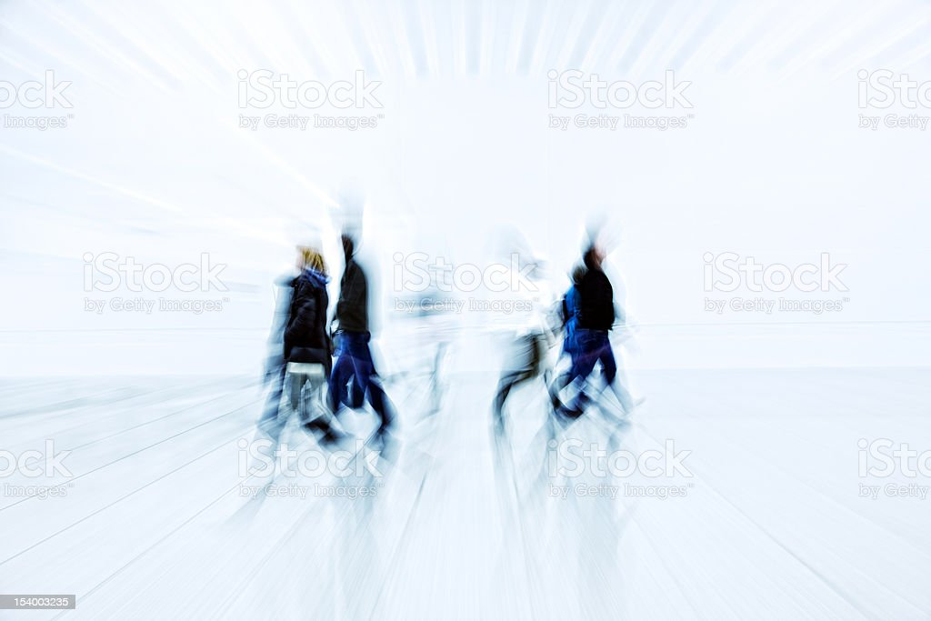 Abstract Blurred People Rushing Through Futuristic Interior royalty-free stock photo
