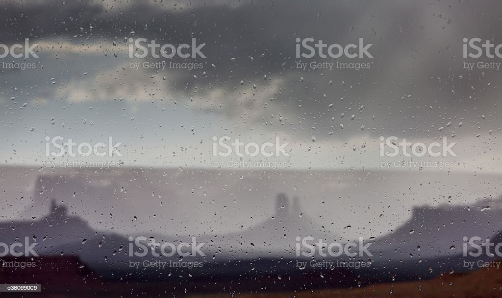 Abstract blurry background: view through the wet window stock photo