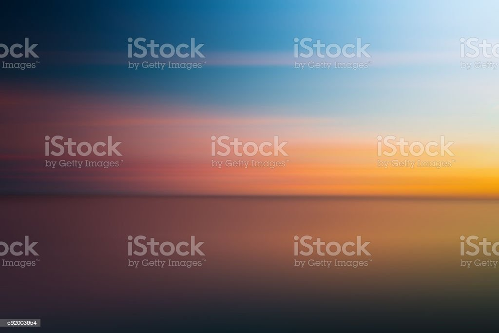 Abstract blurry dramatic Sunset in Long Exposure for background stock photo