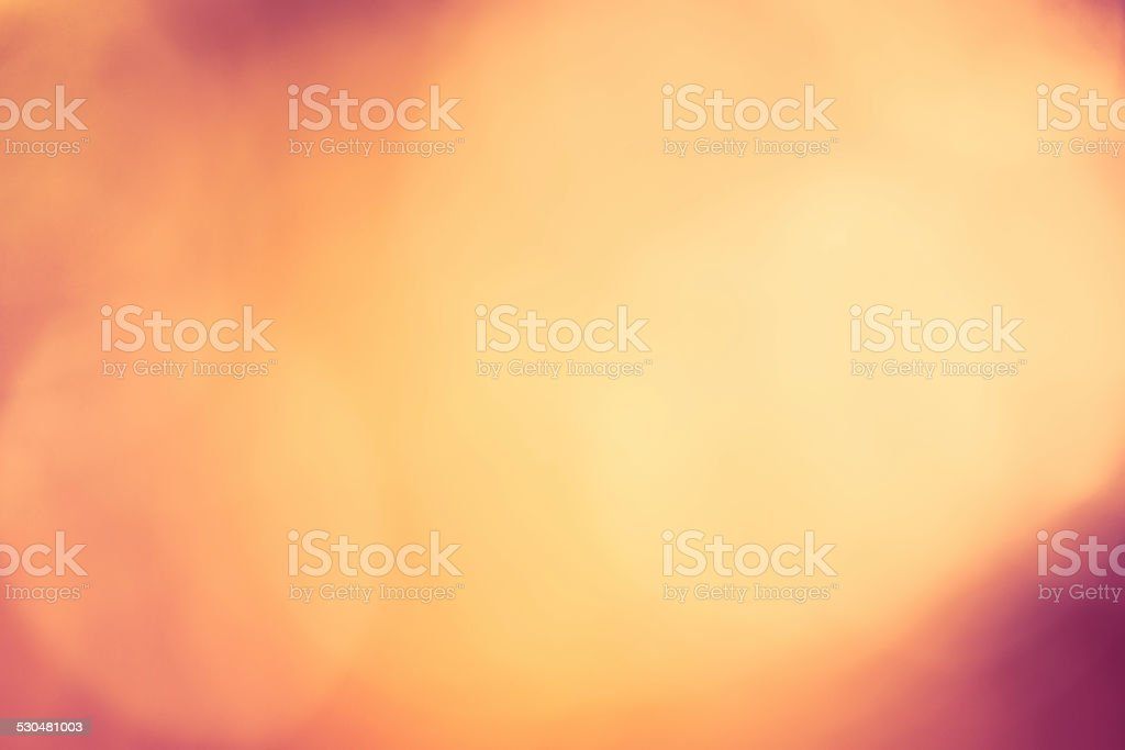 Abstract bokeh holiday background in festive red and yellow stock photo