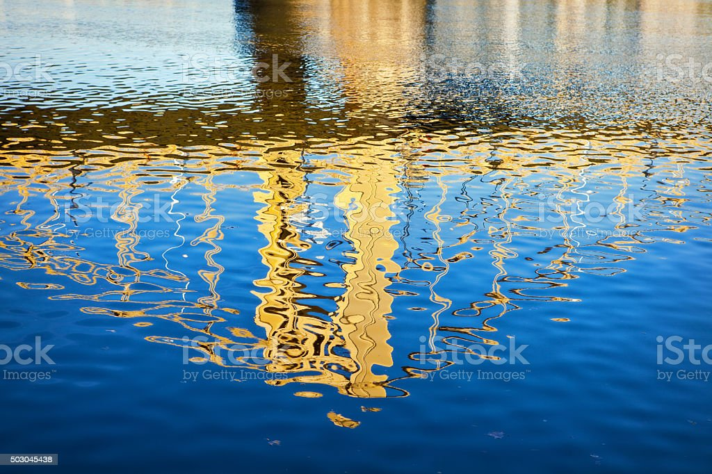 Abstract Bridge Reflecting In River Water stock photo