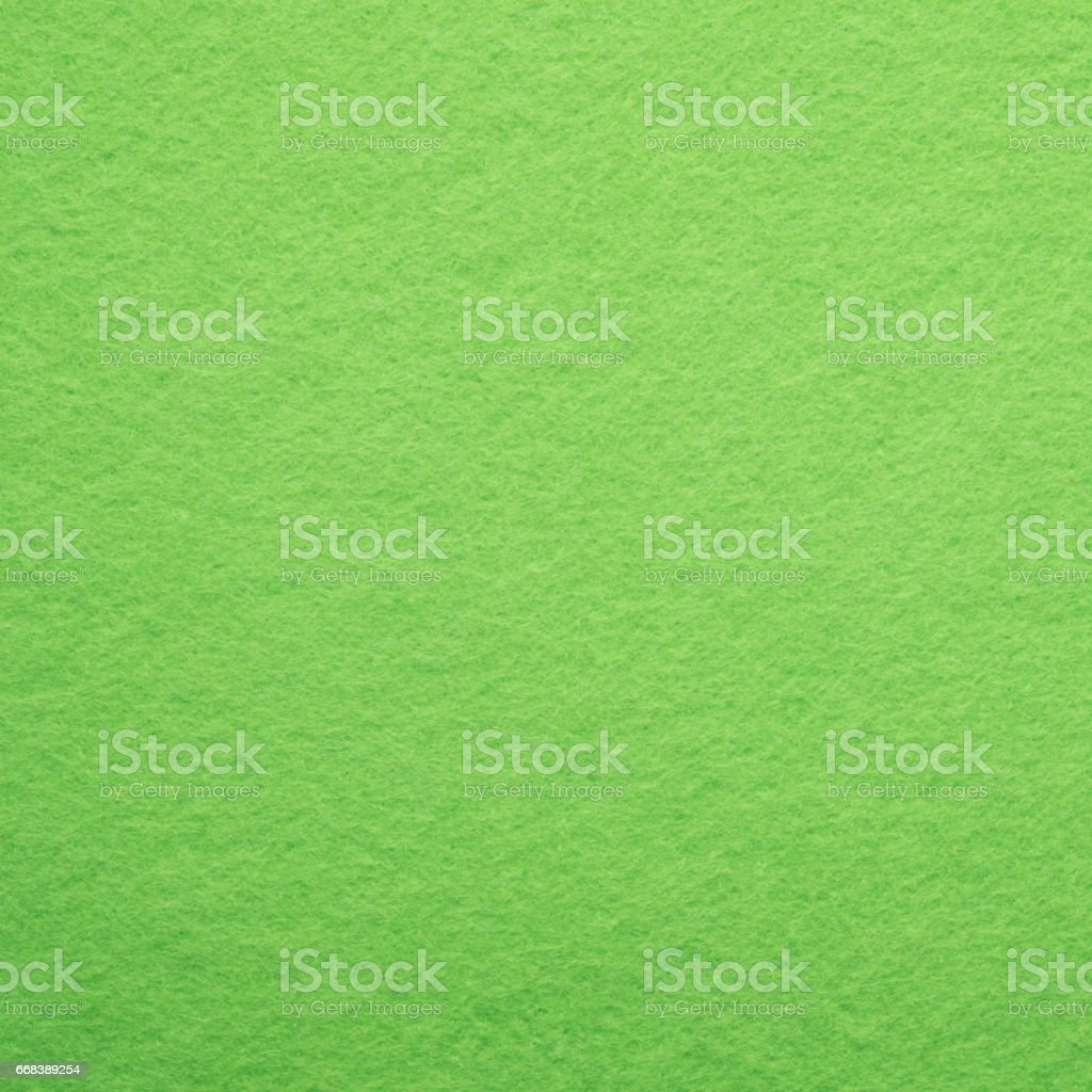 Abstract bright green felt cloth as background and square stock photo