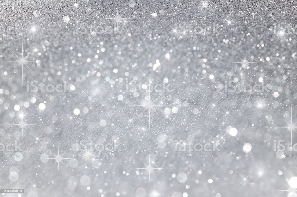 Blurry abstract bokeh lights on grey or silver background with...
