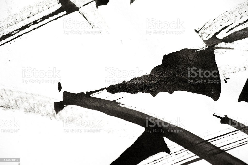 Abstract brush strokes and splashes of paint on paper stock photo