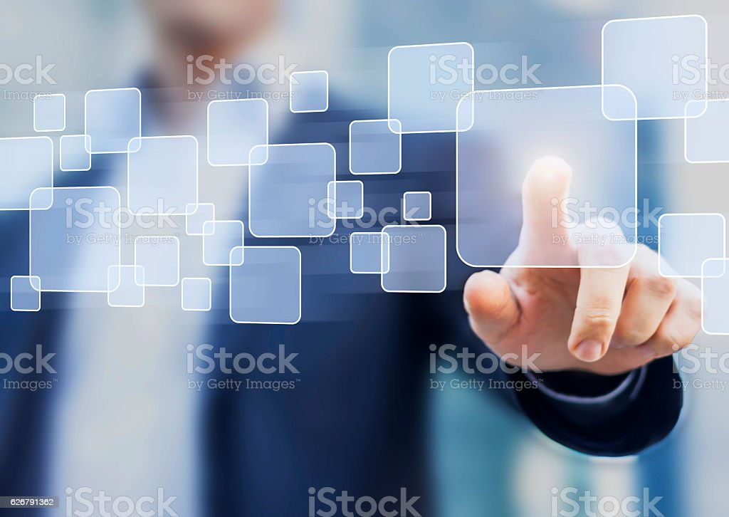 Abstract business concept, businessman touching button on a virtual interface stock photo