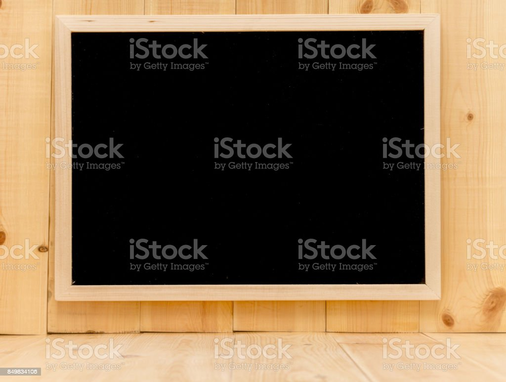 Abstract chalk blackboard with wood border frame on pine wood wall , ready used as background for add text or graphic stock photo