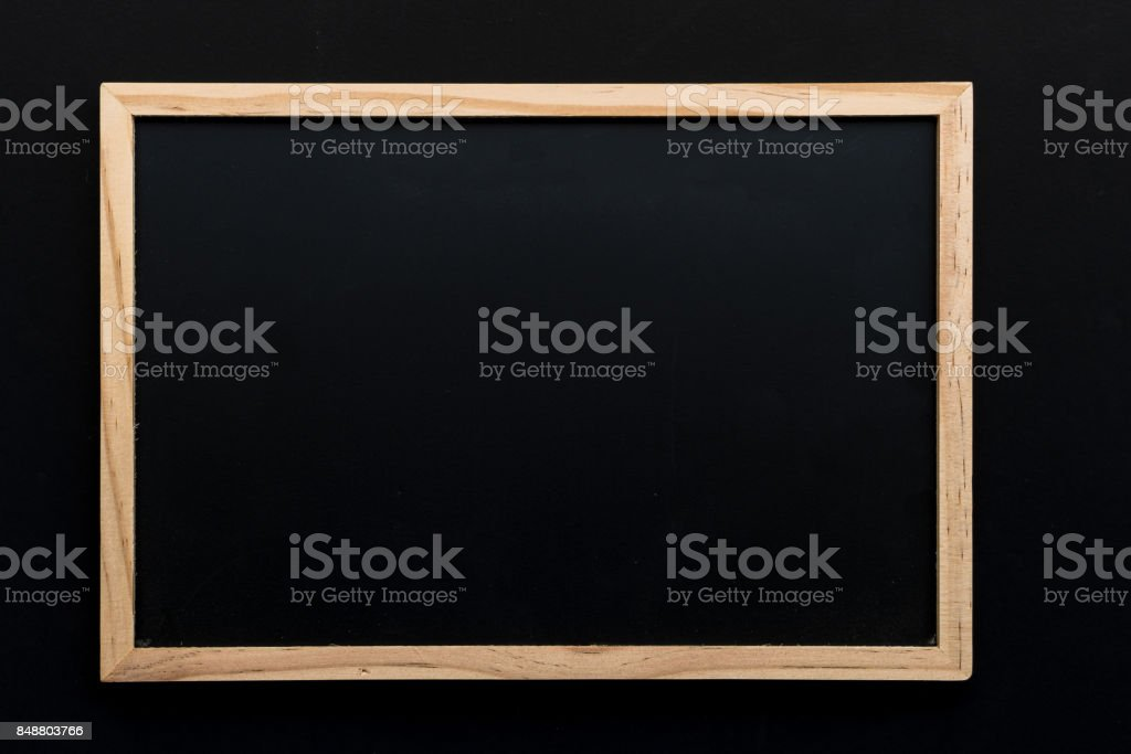 Abstract chalk blackboard with wood border frame ready used as background for add text or graphic stock photo
