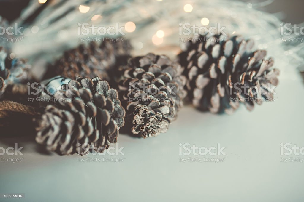 Abstract Christmas decoration Pine cone with defocused bokeh lights stock photo
