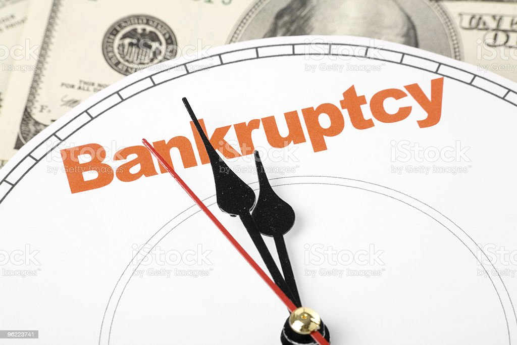 Abstract clock bankruptcy concept as hands approach midnight royalty-free stock photo